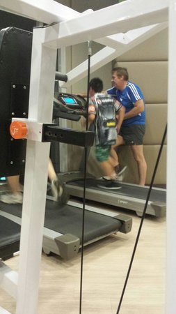 The Exchange Regency Residence Hotel : Gym on the 3rd floor. Dad and son working out.
