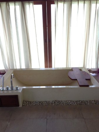 Anantara Dhigu MaldivesResort: bathtub with curtains for privacy, opens and looks into the ocean
