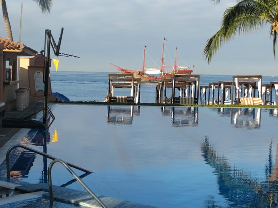Crown Paradise Golden Resort Puerto Vallarta : Pirate ship in front of resort .. view from buffet side of pool
