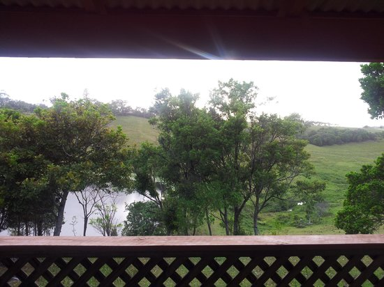 Byron Bay Farmstay: our veranda.lake and kayaks.