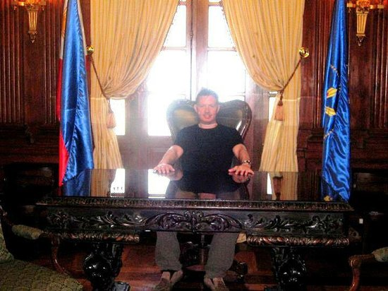 Presidential Museum and Library: My fiancé sitting on Pres. Marcos's desk. No, he's not going to declare the Martial Law. :P