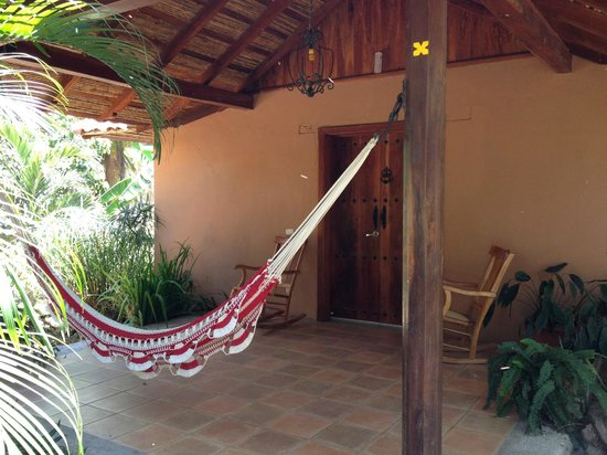 Finca San Juan de la Isla: hammock on patio outside of room