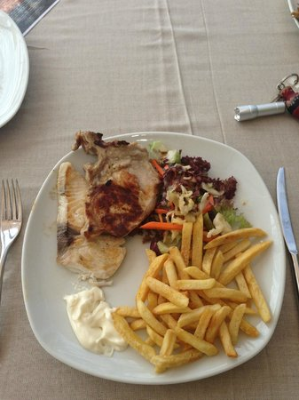 KIHAA Maldives Island Resort & Spa: One food option - jack fish and chicken with salad and fries