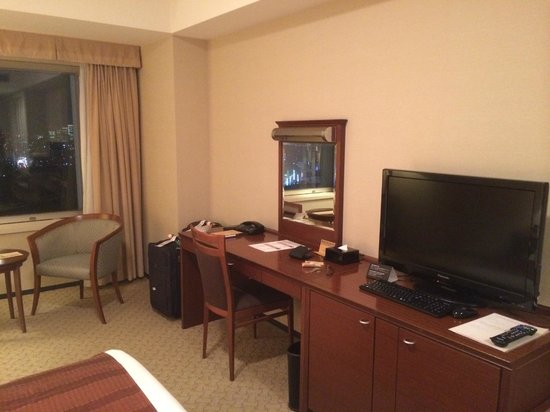 Hotel Century Southern Tower: Desk and TV area. The small frig is below the TV