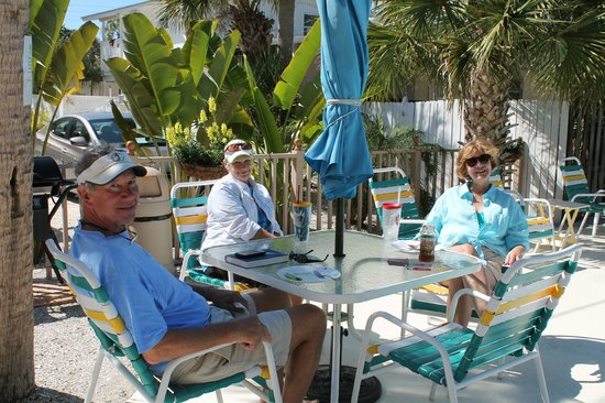 The Ringling Beach House - A Siesta Key Suites Property: Guests enjoying pool area in the sunshine
