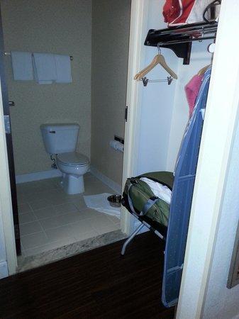 La Quinta Inn Statesboro: bathroom,  closet area with iron and board