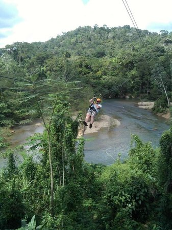 Butts Up Cave Tubing : Ziplining across the water - one of six lines