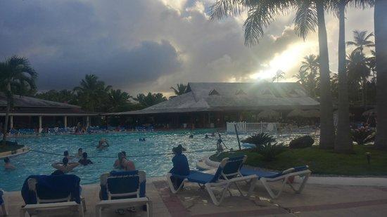 Grand Bahia Principe San Juan: chilling by the pool at sunset
