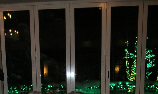Ludwig's Restaurant: soft green lights through the glass doors of Ludwig's Terrace