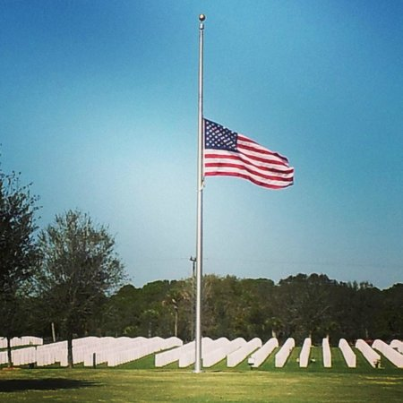 Sarasota National Cemetery : Flag at half-mast over markers