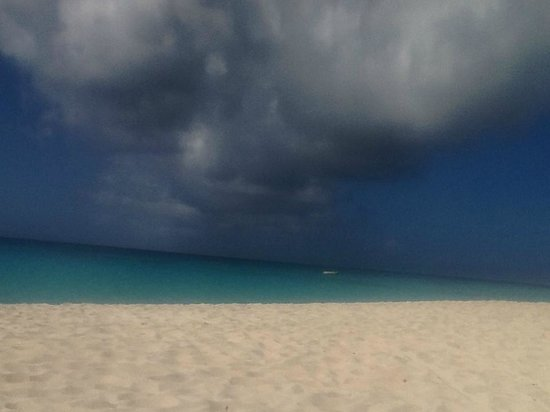 Amanyara beach with scattered storm clouds