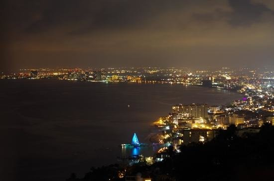 Grand Miramar All Luxury Suites & Residences: view of pv at night from hotel