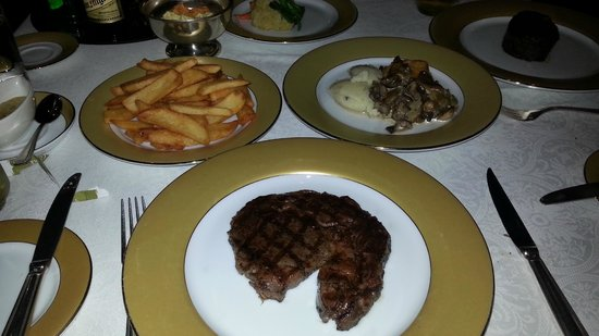 The London Grill: Rib Eye Steak with sides...