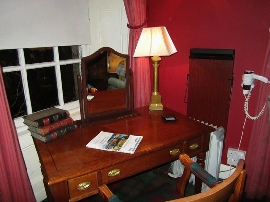 Dalmeny Park Country House Hotel: desk with lamp and whats on guide, dated 2012