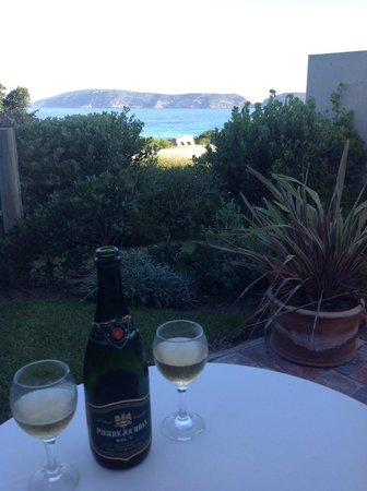 The Robberg Beach Lodge: Wine on the patio of our room.  Life is good!
