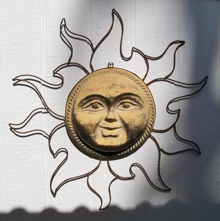 A Place in the Sun Garden Hotel: Mr. Sun on the patio.