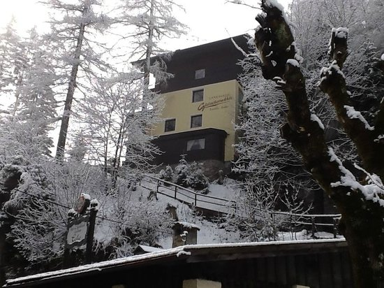 Landhaus Gletschermuehle : Side view of house in the snow. Picturesque B route. A little path but not necessary to use.