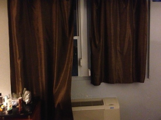 San Juan Beach Hotel : two different curtains. did not fit window at all