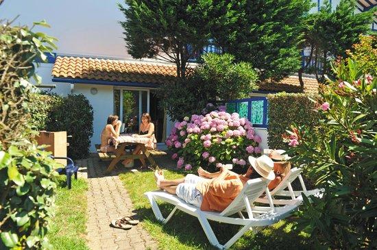 Camping Duna Munguy : Jardin d'un des appartements