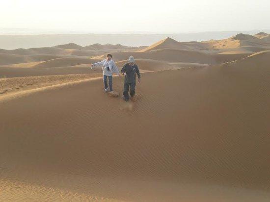Desert Nights Camp: Mom & Dad running down a sand dune