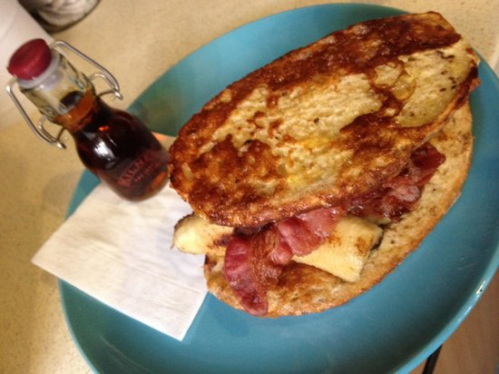 The Bluebird Cafe: Sour dough French toast with caramelised banana, crispy bacon & Canadian maple syrup.