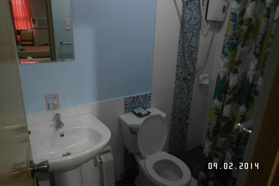 Ati-Atihan Festival Hotel: Small basic shower and toilet.