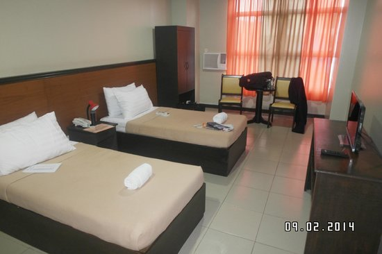 Ati-Atihan Festival Hotel: Two large beds.