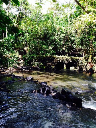 Free Natural Hot Springs: View from up river of bridge and entrance area. Trail on left side with easy access to water.