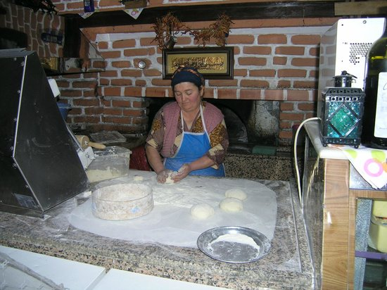 Unal Restaurant : Bread being prepared for baking in oven behind