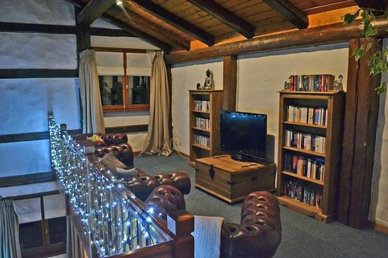The Nest: TV mezzanine room with flat screen TV, selection of DVD'S, books and games