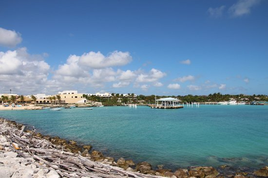 La Yola Restaurant : view from end of Cap Cana marina entry; rest, is thatched roof one in center