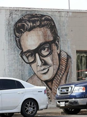 Buddy Holly Statue and West Texas Walk of Fame: a wall painting on the 19th street right side of the Walk of Fame