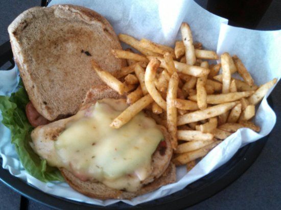 Alibi's Sports Bar and Grill: Southwest Chicken Sandwich with sour cream and chive fries