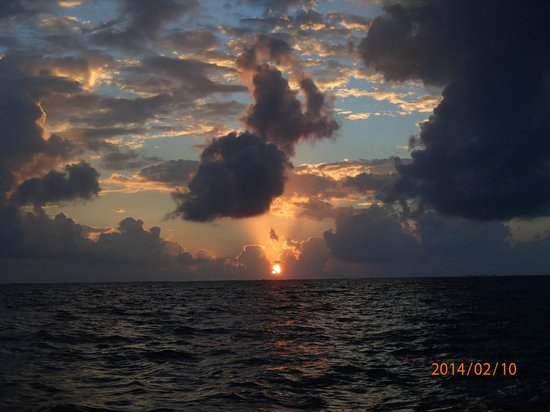 Anwar Tours: Sunrise...between Caye Caulker and the mainland.  Ricco said,