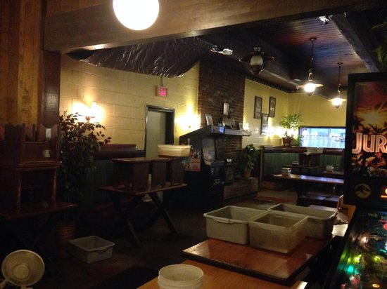 Joey's Pizza : Yes it is raining inside the restaurant...tarps, buckets. How can you let your restaurant get to