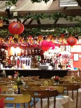 The Gurkha: The bar area with plenty of plastic roses on the right lol