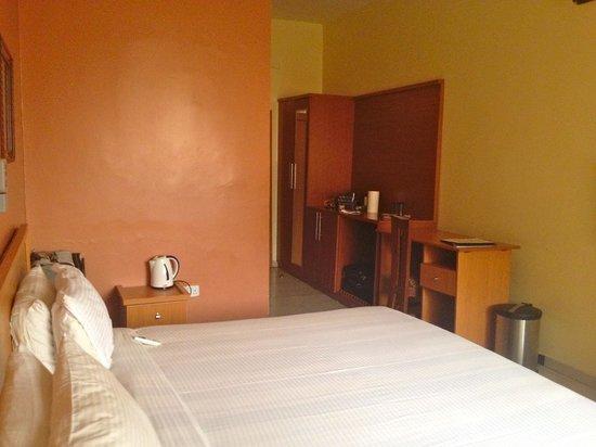 3J's Hotels: On right: desk, counter, mini-fridge, closet
