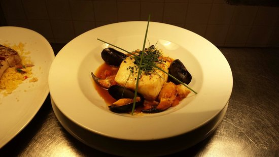 Gallagher's: Halibut with tomato and languistine  broth crab and.mussels