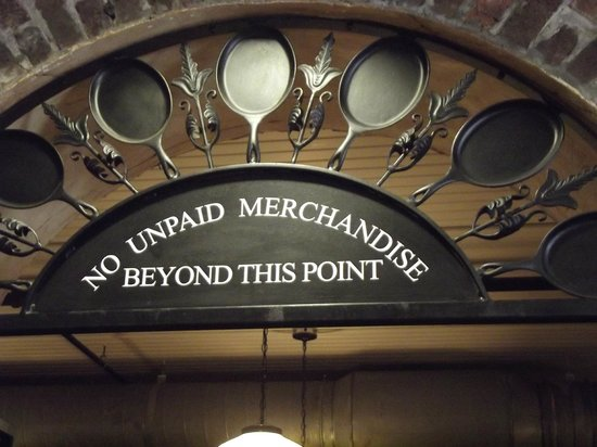Lady & Sons: Sign above store arch leading to restaurant