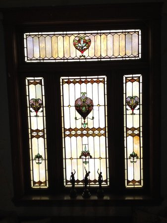 The Oliver-Leming House: Stained glass window in stairway.  Always used in the homes of the architect.  J. B. Legg.
