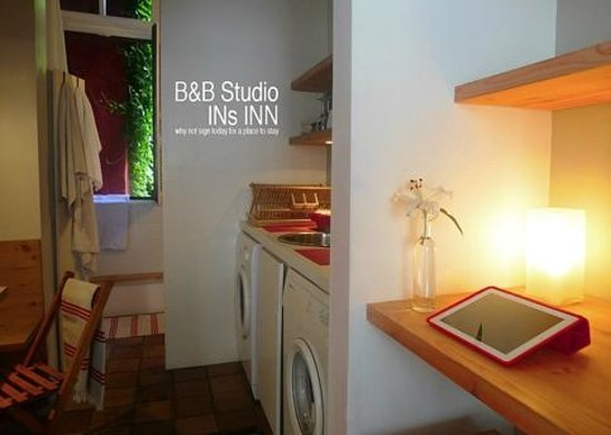 Bed & Breakfast Studio INs INN: Laptoptable and view on kitchen.