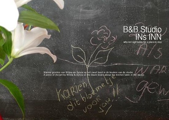 Bed & Breakfast Studio INs INN: Message on black board above table in the breakfast corner.