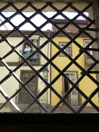 Centro Portugues de Fotografia: Looking out the barred window