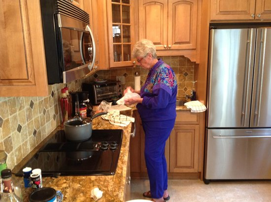 Alhambra Beach Resort: My friend Alice enjoying the full kitchen in Room 5
