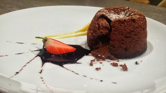 Monty's Restaurant and Bar: Hot Chocolate Souffle Served With White Chocolate
