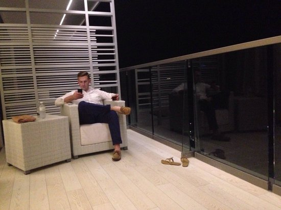 Secrets The Vine Cancun : Hanging out on the couches on our balcony