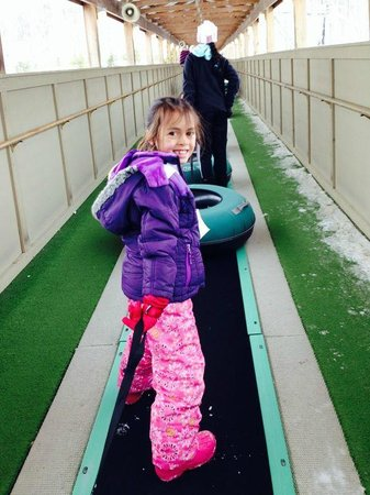 Whitetail Mountain Resort: My daughter on the conveyor belt up to the top