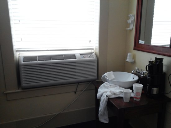 1905 Basin Park Hotel: no room for a sink in the bathroom. also, window air helps reduce the noise from neighbors using