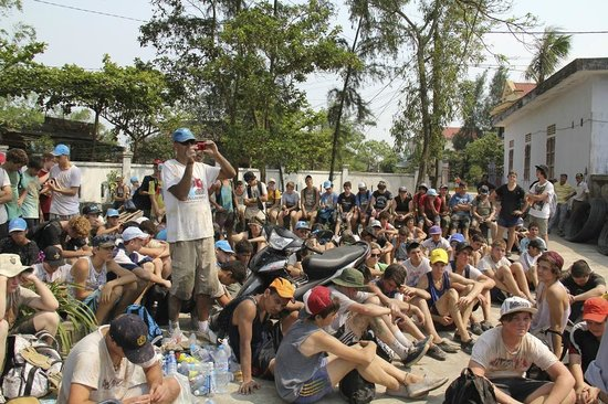 Viet Vision Travel - Day Tours: Group of 100 school boys doing community service in Viet Vision Travel's tour in Hue