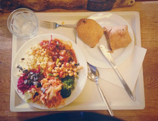 Country Life: Plate of various veggies (amazing kimchi and carrot salad) and a Mexican style burrito.
